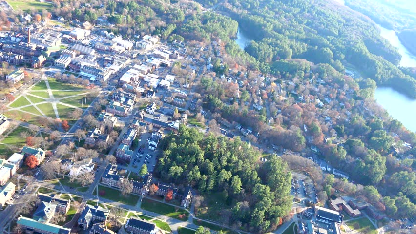 AERIAL Hanover, New Hampshire, close view, Dartmouth College area. Looking down over small  town near White Mountains.