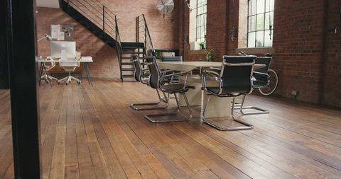 Empty office trendy loft apartment warehouse conversion steadicam walk through around boardroom table