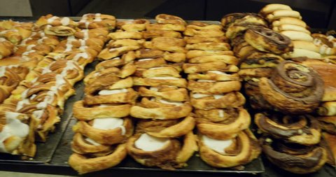 Panning over danish pastry in traditional Copenhagen cafe - traditional Danish cuisine with delicious foud pastries