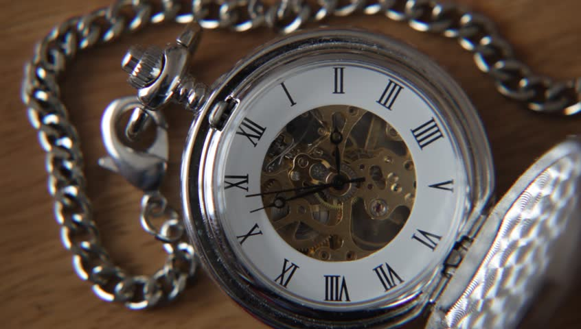 Old silver pocket watch with the second hand moving.