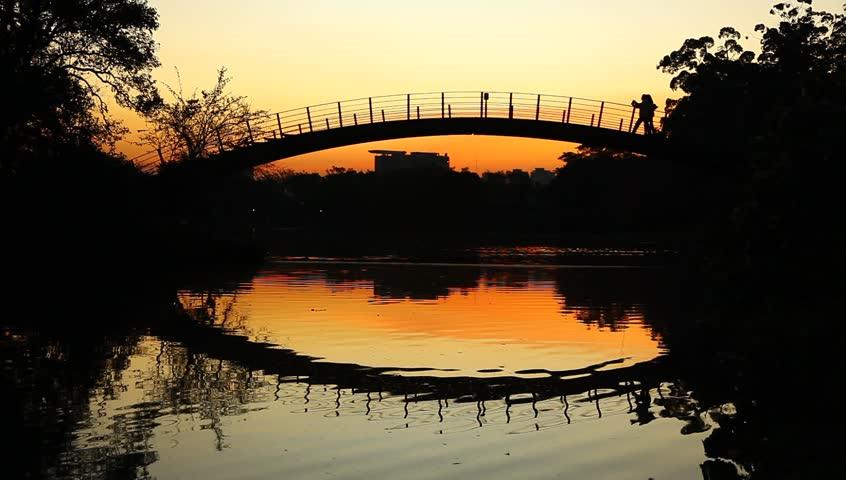Romantic sunset on bridge in Park Ibirapuera Sao Paulo Brazil