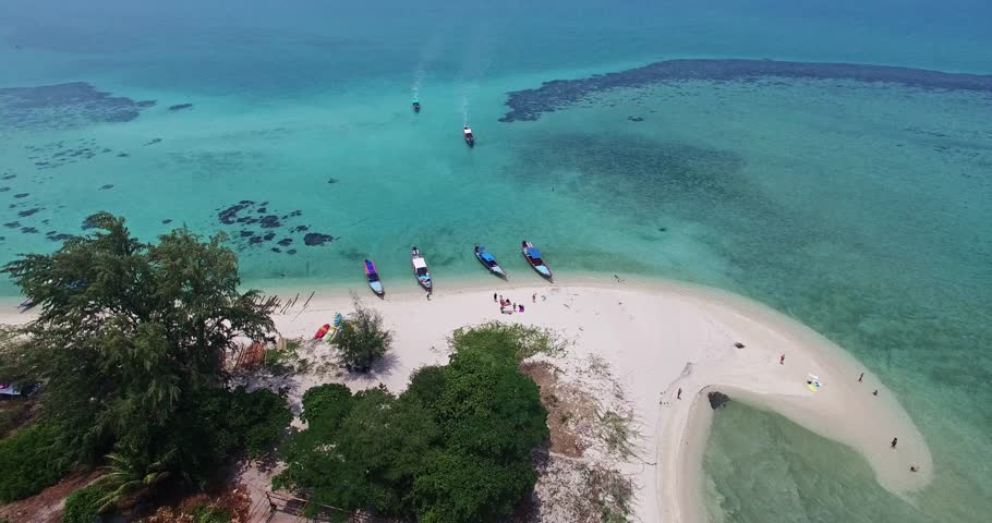 Aerial view on Thai traditional boats in Thailand. Samui island. Clear water and snorkling.