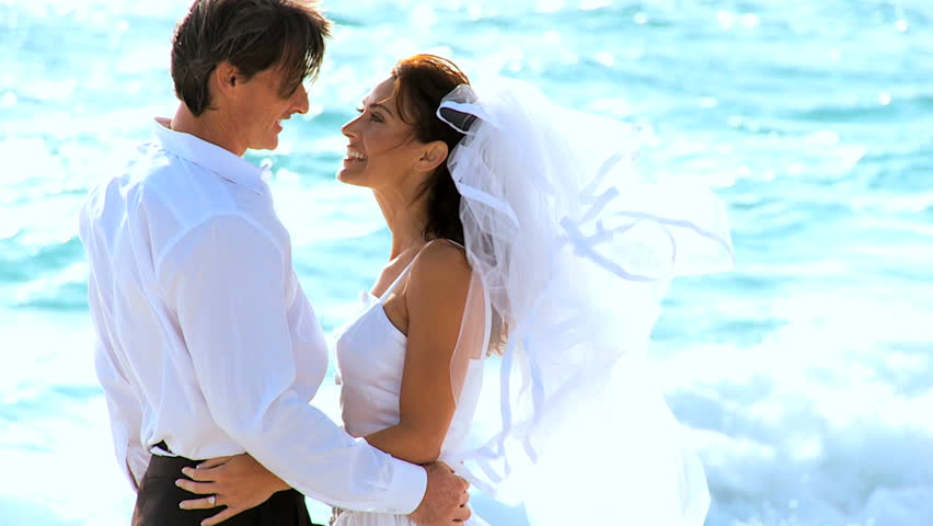 Loving In Close Up Sharing A Kiss After Their Oceanside Island Wedding Stock Footage Video 1274800 Shutterstock