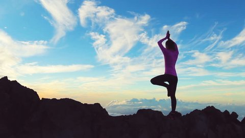 Young Woman Standing Yoga Pose on top of Mountain. Reaching the Top. Healthy Active Lifestyle.
