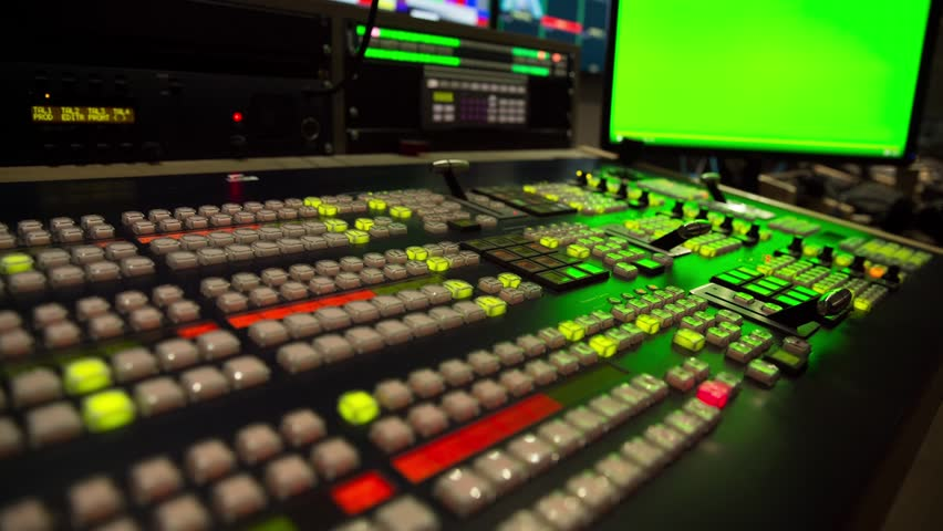 Broadcast Tv Studio Production - Vision Switcher  Studio Director broadcast video mixer operation - Close-up of hand