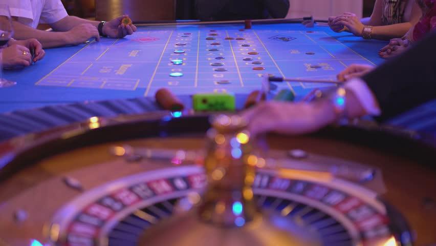 Roulette table in a casino - groupier spins wheel - rien ne vas plus   Shutterstock HD Video #12838343