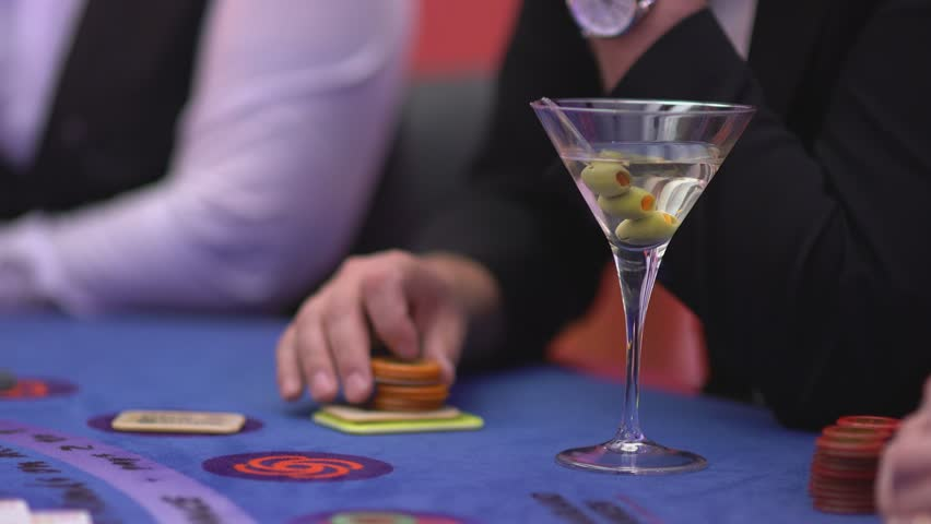 Gambling Black Jack in a casino - nervous gambler playing with tokens | Shutterstock HD Video #12838400