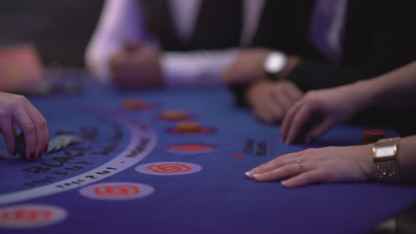 Gambling Black Jack in a casino - counting gaming chips | Shutterstock HD Video #12838430
