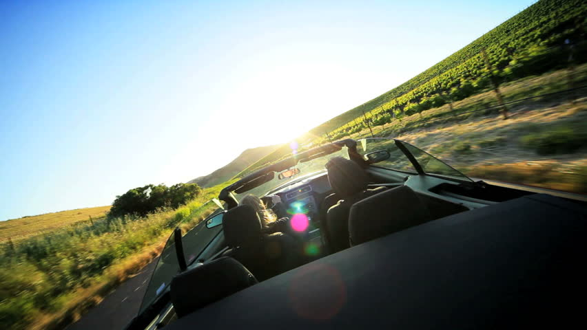 Visitors driving an open top car through the wine region of Napa Valley as the sun sets | Shutterstock HD Video #1284790