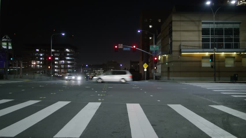 Downtown: Los Angeles, CA USA Set #109 - Direct Front angle: Car travels S on 2nd St., then turns N onto Olive St., on a clear evening in light traffic. Shot on RED Dragon. | Shutterstock HD Video #12852110