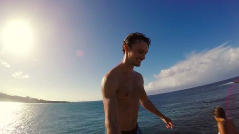 POV Slow Motion Sunset Cliff Jumping Backflip. Athletic Young Man Jumping From Cliff Into Ocean. Adventure Extreme Sports Lifestyle Hobby Vacation