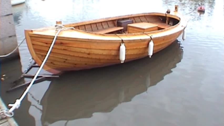Wooden Rowing Boat In A Wharf Tripod 16x9 Stock Footage Video 12860