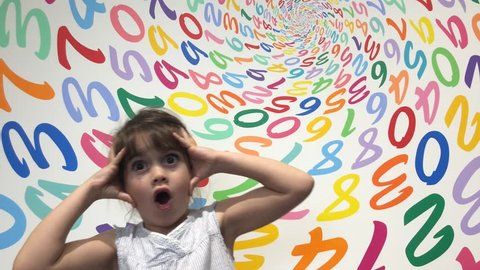 Little girl (age 5-6) frustrated with arithmetic problem. Children education concept