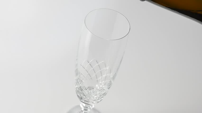 Pouring sparkling wine in a glass | Shutterstock HD Video #12878690
