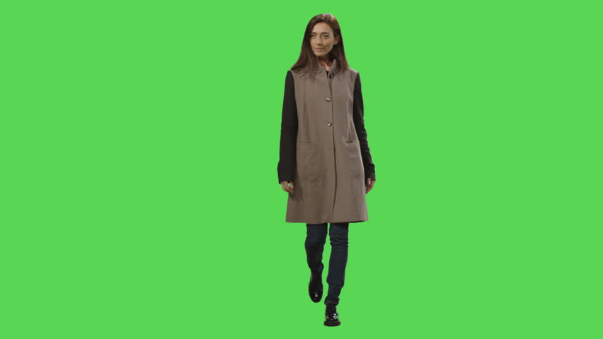 Casual brunette female is walking on a mock-up green screen in the background. Shot on RED Cinema Camera in 4K (UHD). | Shutterstock HD Video #12886100