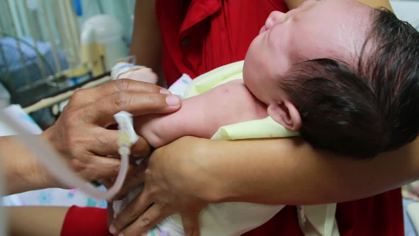 CHACHOENGSAO, THAILAND - SEPTEMBER 13 : People who do not know his name. Take the kids to the hospital to receive treatment for physical health. On September 13, 2014 in Chachoengsao, Thailand. | Shutterstock HD Video #12938564