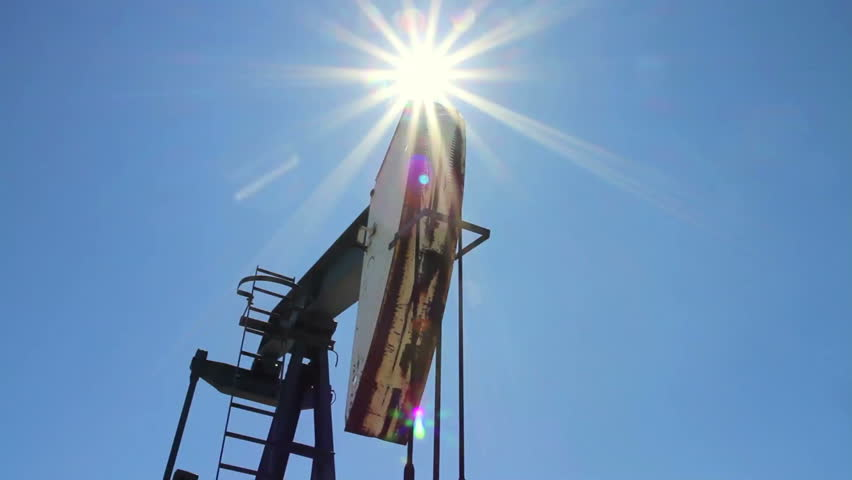 Crude oil pump jack with sunburst