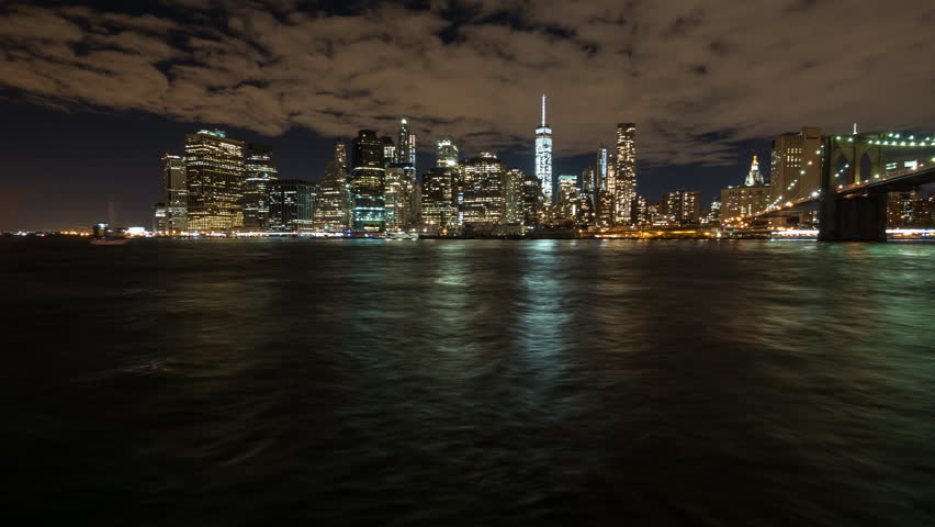 night time lapse of the waterfront of manhatten in new york
