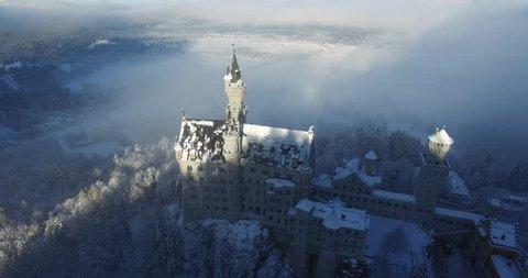 Aerial view of  Neuschwanstein Castle at sunrise in winter landscape. Germany