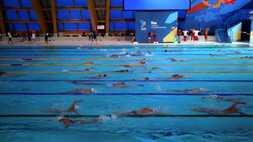 KAZAN, RUSSIA   27 JULY 2015: Athletes Swimmers Train In A Pool Of Aquatics