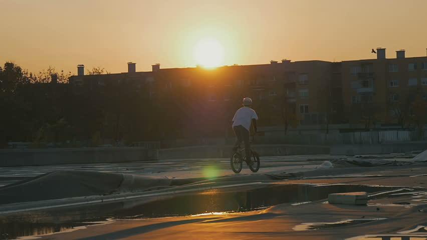 A bmx rider on a rooftop #13069190