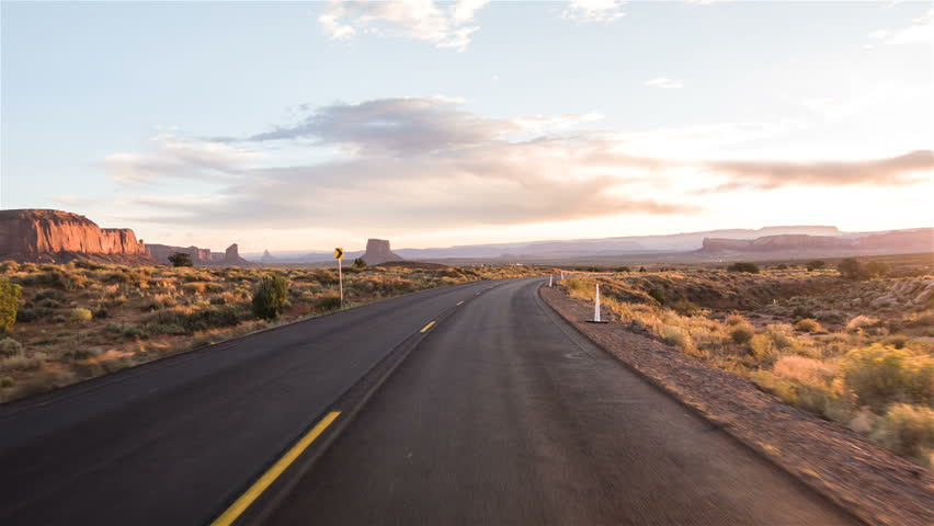 Driving USA: Sunset sunrise point of view shot along empty desert highway through Monument Valley, Arizona Utah #13074620