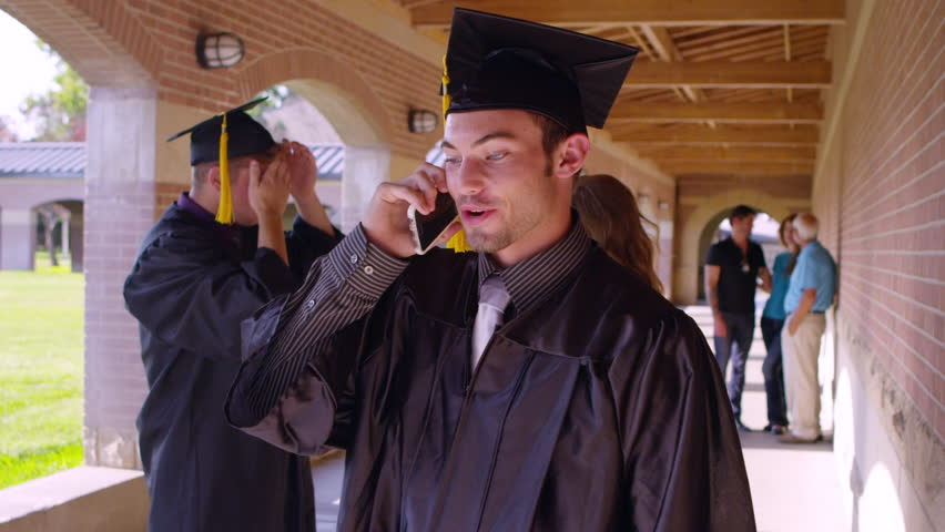 Female graduate talking on the cellphone | Shutterstock HD Video #13096340