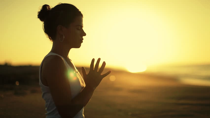 young woman practices yoga on a beach at sunrise #1310398