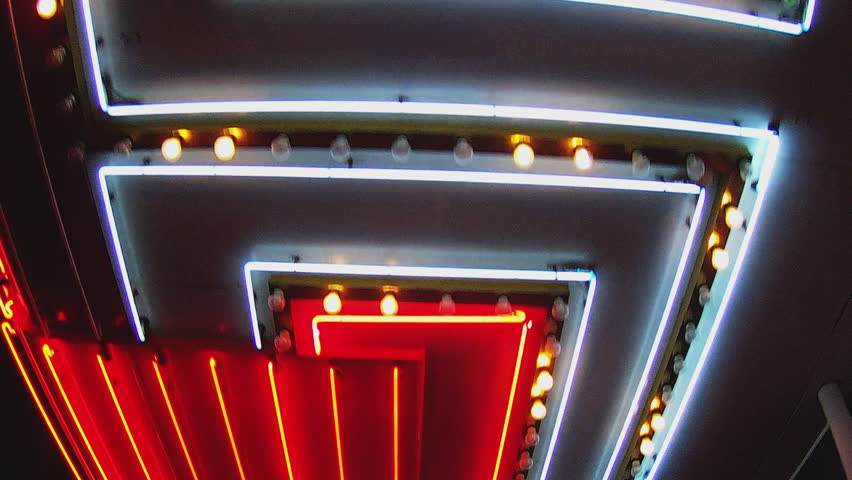 Low angle shot looking up while walking under bright casino lights on Fremont Street in Las Vegas Nevada. Generic neon tubes of light pass by overhead.  | Shutterstock HD Video #13118750