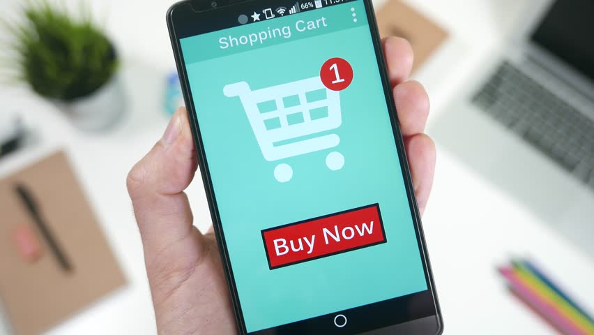 Pressing the Buy Now button to shop and pay a online store on smarrtphone. | Shutterstock HD Video #13135607