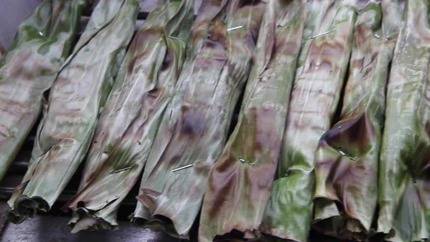 Establish shot of food Otak otak from Indonesia asia, this food very popular in local