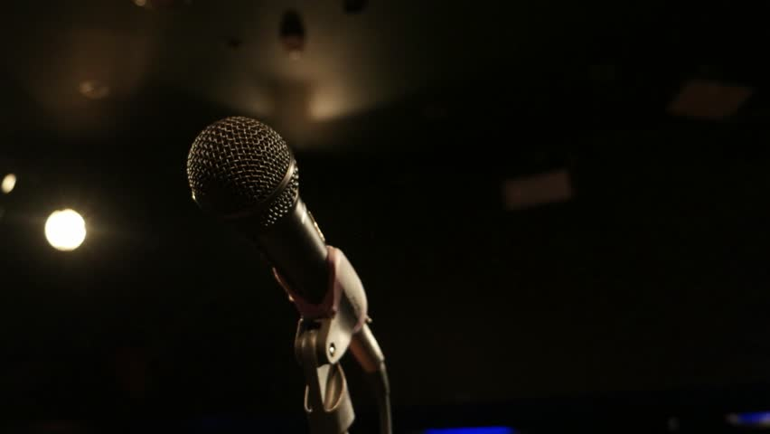 Microphone on tripod in recording studio close-up illuminated floodlights, Close up