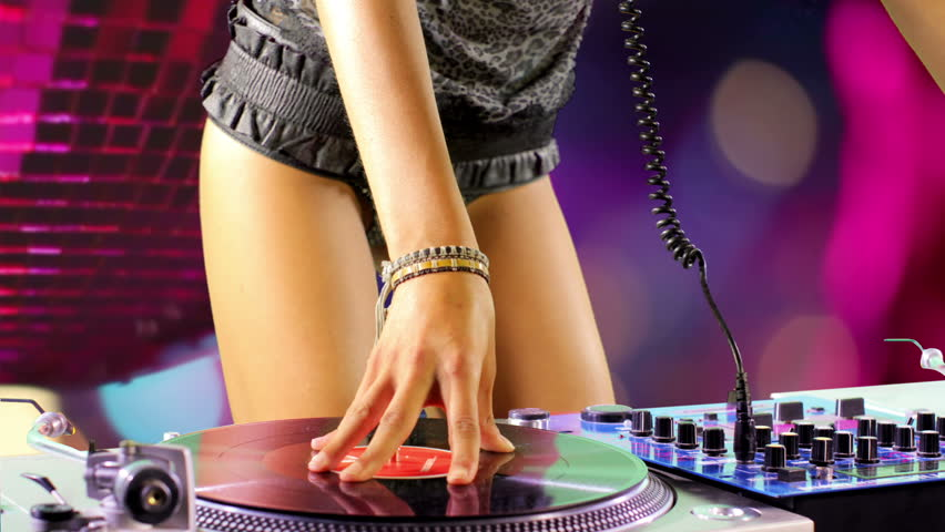 close up shot of sexy female dj dancing and playing records