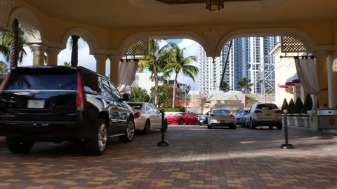SUNNY ISLES BEACH - DECEMBER 2: Stock video of the valet parking at the Mansions at Acqualina which is a luxury highrise condo located at 17749 Collins Ave December 2, 2015 in Sunny Isles Beach FL