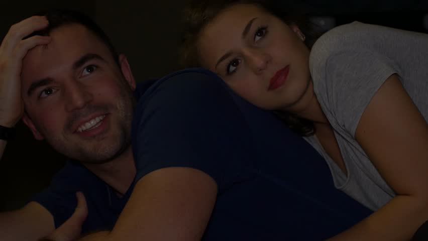 Young attractive couple cuddling watching TV | Shutterstock HD Video #13201400