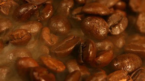 Roasted coffee beans emit smoke.