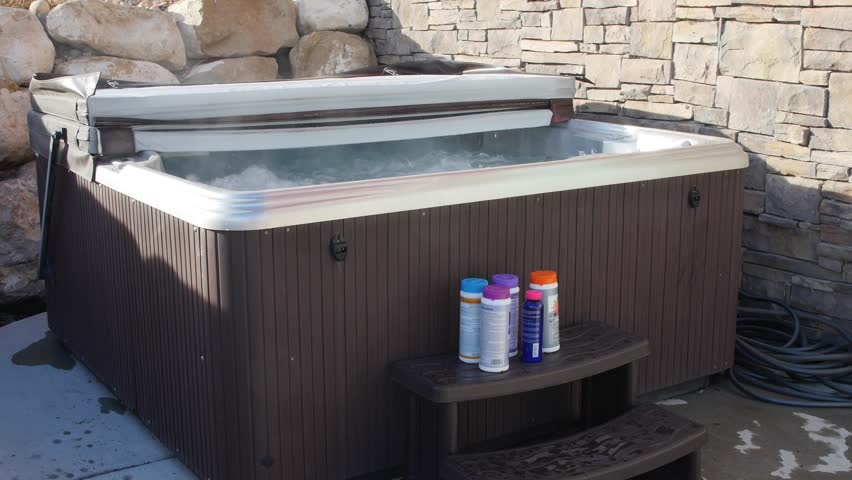 A Man Prepares To Do Weekly Maintenance On His Hot Tub And Put ...