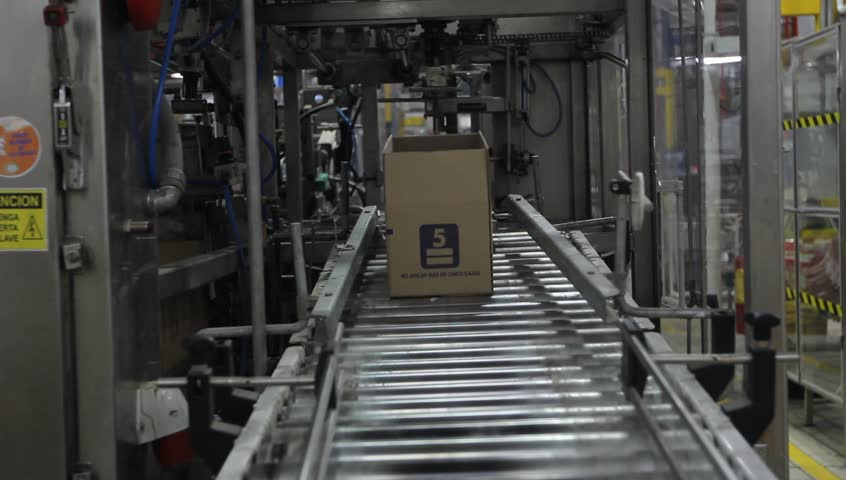 PRODUCTION LINE, FACTORY - Boxes of products move down a production line towards the camera. - Santiago, Chile, July, 2014 | Shutterstock HD Video #13244810