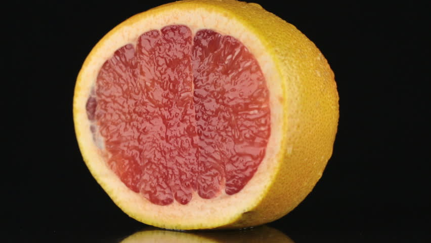 Half of grapefruit, rotating on a black background.  | Shutterstock HD Video #13251170