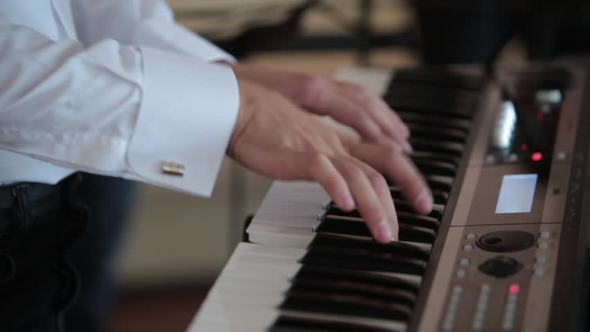 Pianist plays the piano | Shutterstock HD Video #13260200
