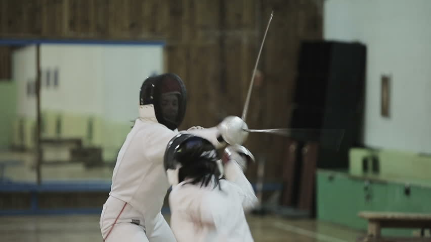 Two young women fencers on a training. Slow motion