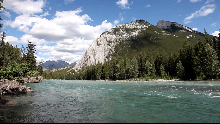 Bow river with a rapid current in a valley between mountains in Banff National Park (Alberta, Canada)