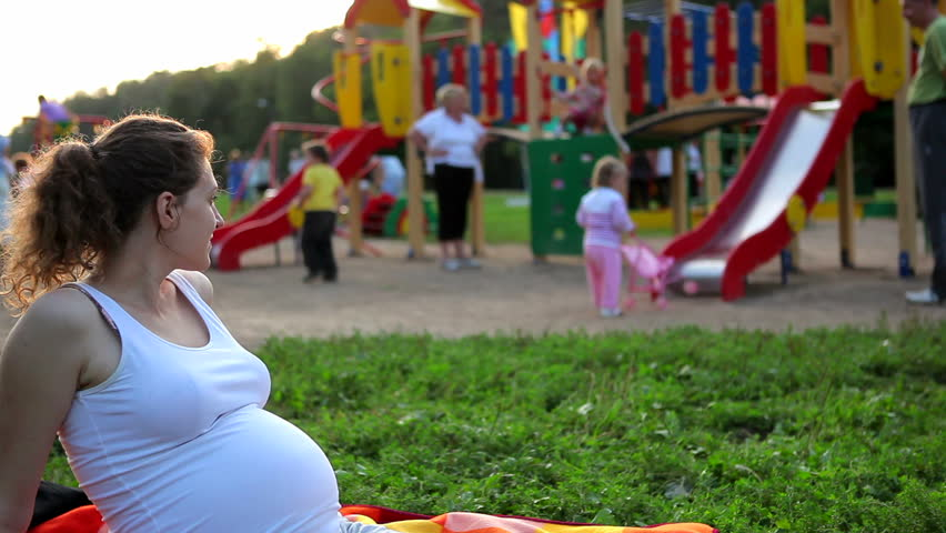 Pregnant woman looks at the children on the playground | Shutterstock HD Video #1331881