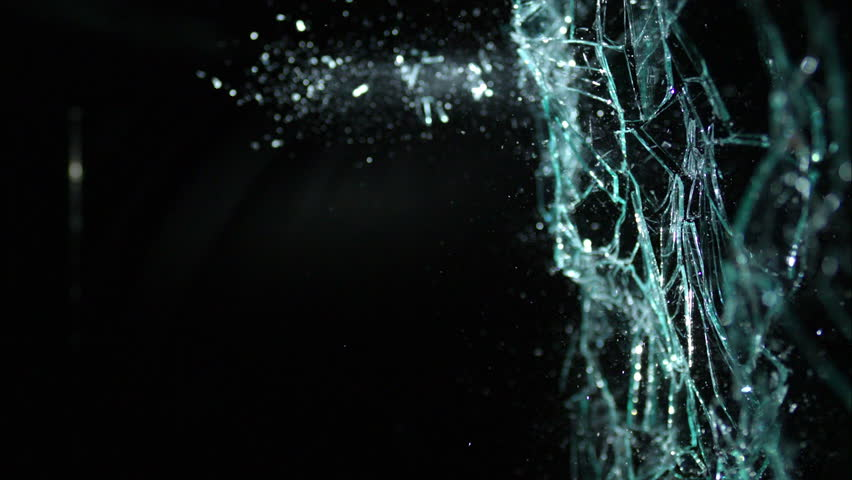 Plate glass window shattering on black from the side, isolated on black breaking in slow motion in 4k  #13326560
