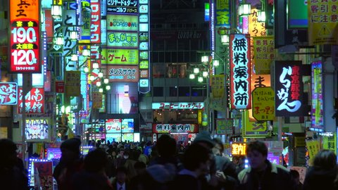 Large crowd on a popular entertainment street in the Kabukicho area in Shinjuku Tokyo at night circa February 2015