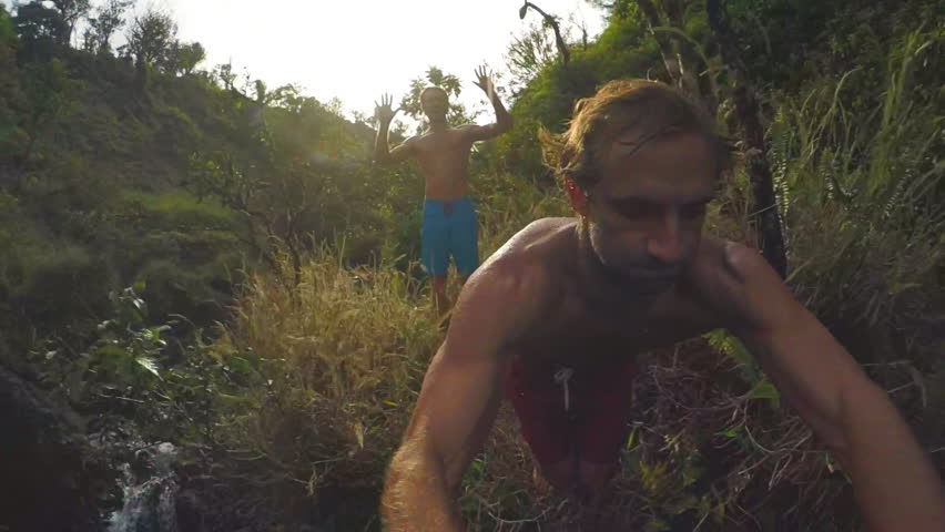 POV Slow Motion Cliff Jumping.  Lush Green Jungle in Hawaii. Extreme Sports GOPRO Selfie #13340510