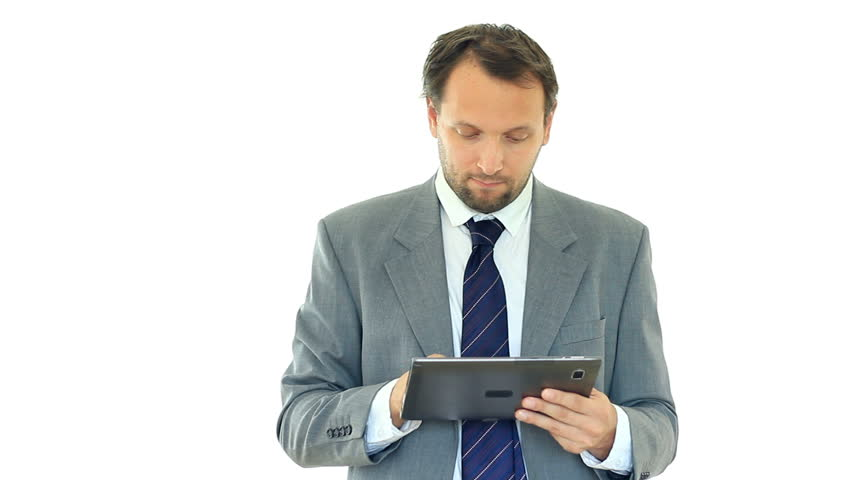 Unhappy businessman looking at bad news on tablet computer, isolated