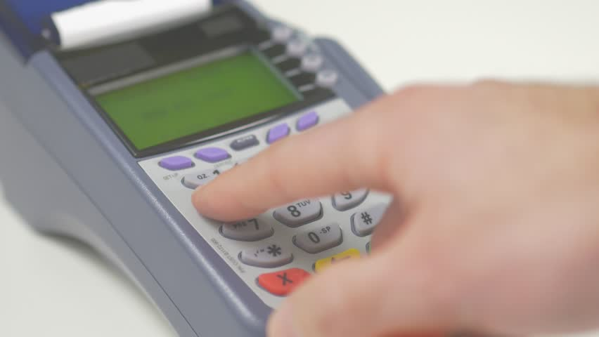 Paying with a credit card on a store terminal and entering the PIN number to complete the transaction. Great to illustrate a shopping experience. | Shutterstock HD Video #13356680