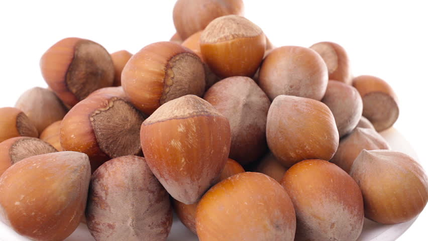 A pile of shelled hazelnuts rotating smoothly. Tripod used under studio lighting. - HD  sc 1 st  Shutterstock & A Pile Of Shelled Hazelnuts Rotating Smoothly. Tripod Used Under ... azcodes.com