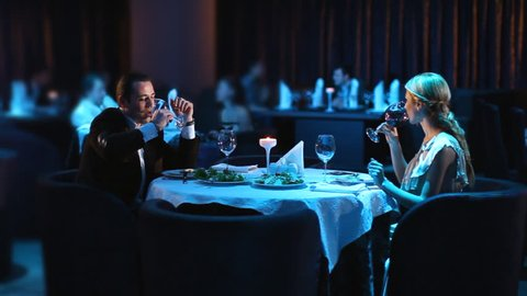 Young couple dining exclusively in a romantic atmosphere in restaurant.